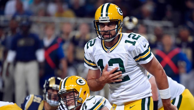 Packers quarterback Aaron Rodgers (12) calls a play against the St. Louis Rams during the first half at Edward Jones Dome.
