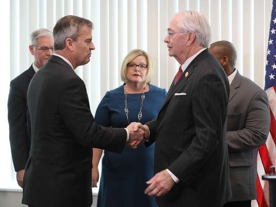 Hal Heiner, left, shakes hands with Don Parkinson,