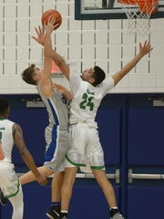 Novi's Tariq Woody is called for a foul as Lakeland's