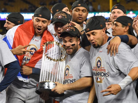 Houston Astros second baseman Jose Altuve (center) celebrates with teammates with the Commissioner's Trophy after defeating the Los Angeles Dodgers in Game 7 of the 2017 World Series at Dodger Stadium.