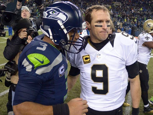 Seattle Seahawks quarterback Russell Wilson (3) and New Orleans Saints quarterback Drew Brees (9) shake hands after the game at CenturyLink Field.
