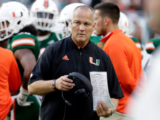 Miami coach Mark Richt calls a play from the sideline vs. FSU. Oct. 6, 2018