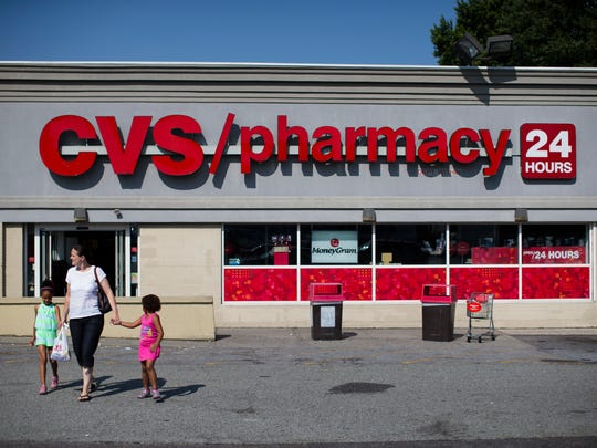 Shoppers leave a CVS pharmacy in the Staten Island