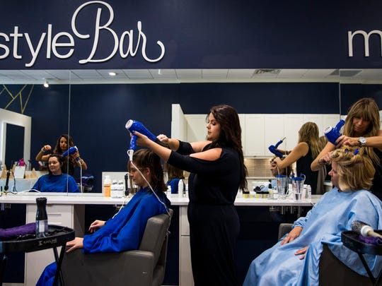 Stylists Lindsey Skott, from left, Christen Ellis and Renee Amato blow-dry and style the hair of Colleen Kerins, from left, Elizabeth Kurtz and Lori Melheim at Simple Beauty Studio in North Naples on Thursday, Aug. 17, 2017.