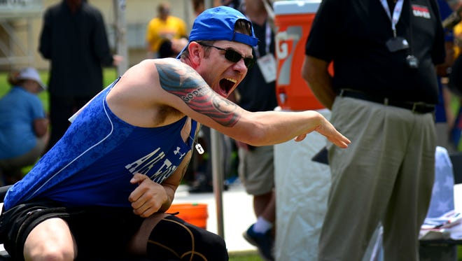 Staff Sgt. David Olson, an explosive ordnance disposal troop from Abilene, Texas, competes in the seated shot put at the 2017 Department of Defense Warrior Games July 5, 2017, at Soldier Field, Chicago, Ill. A brush with suicide occurred near the beginning of 2017, and Olson recounted his personal struggle with suicidal ideations along with the toll his physical and invisible wounds have taken not just on his life, but on those of his loved ones.