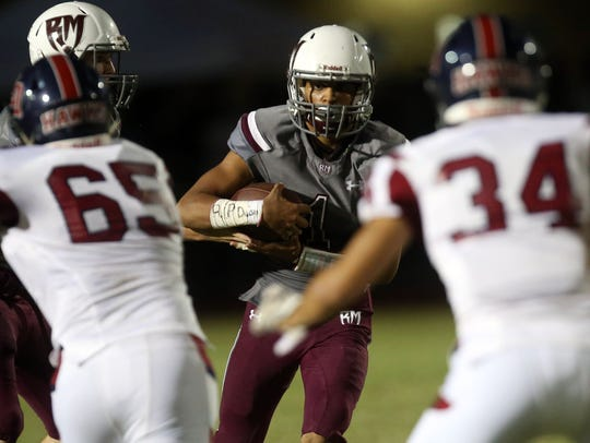 Rancho Mirage's Marques Prior carries the ball against