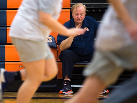 Joey Spann watches his basketball players practice