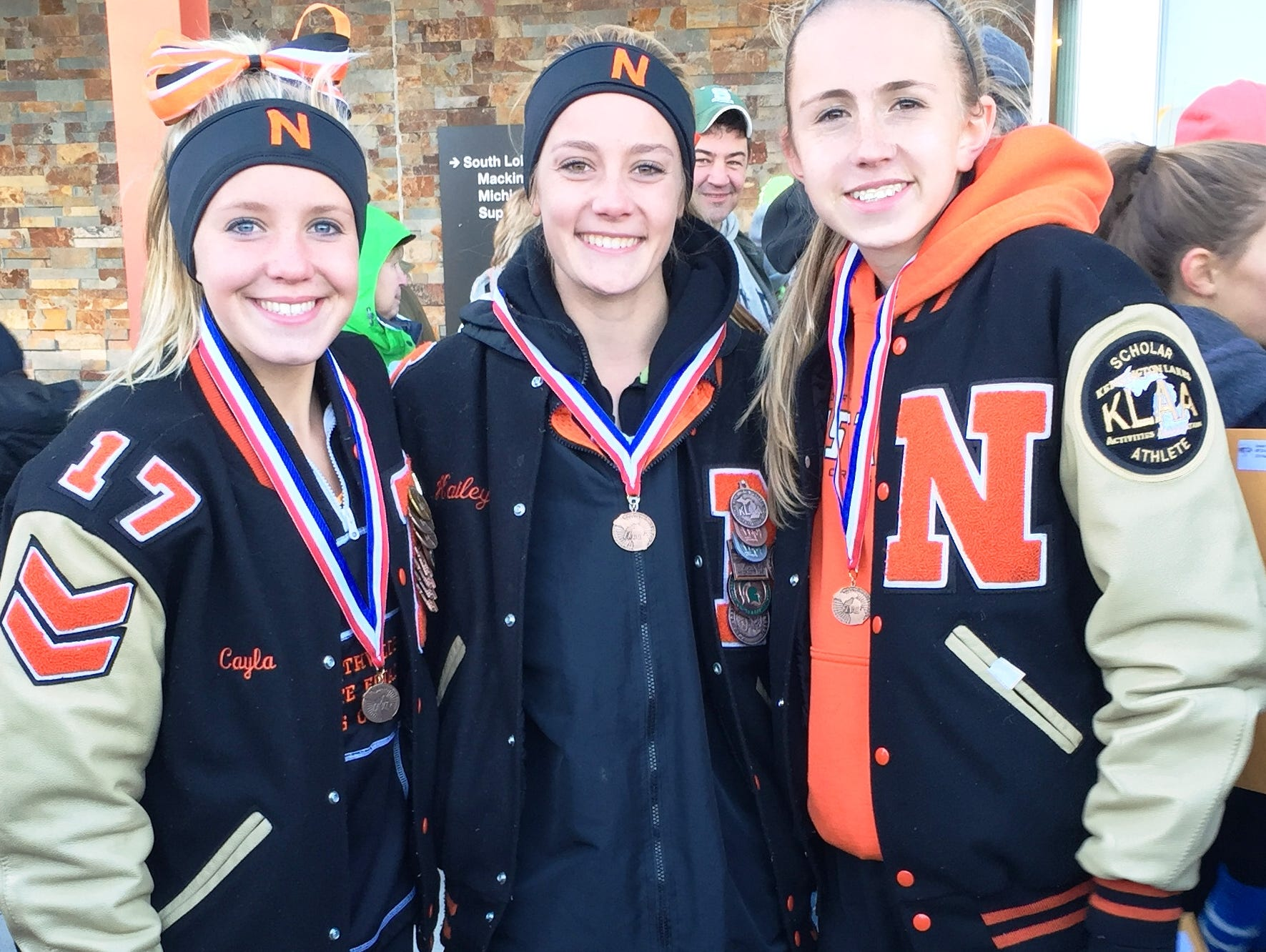 Northville's Cayla Eckenroth (from left), Hailey Harris and Lexa Barrott earned Division 1 cross country all-state honors Saturday at MIS.