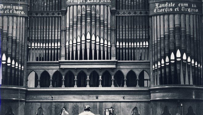 Ron Crowl is shown playing the organ in 1984  at St. Martin of Tour Catholic Church, 639 S. Shelby St.