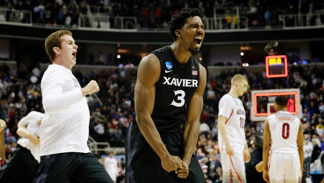 Quentin Goodin celebrates Xavier's win over Arizona.