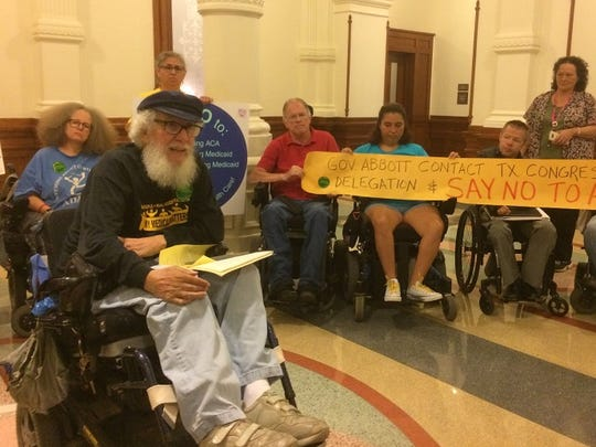 Bob Kafka, an organizer with the disabilities-rights group, ADAPT, leads a protest of state and federal Medicaid cuts at the Texas Capitol on Wednesday.