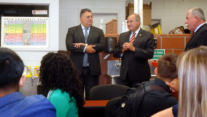 Union County Freeholders Alexander Mirabella (left) and Angel G. Estrada (center) speak with students at the new Law and Justice Mini Academy at Union County Vocational Technical School in Scotch Plains. They were joined by Union County Vocational Technical Schools Superintendent Pete Capodice.