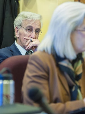 Joel Cook, executive director of the Vermont National Education Association (left), listens as Rep. Mary Morrissey, R-Bennington, and the House General, Housing and Military Affairs Committee consider a bill that would ban teachers' strikes at the Statehouse in Montpelier on Friday, April 3, 2015.