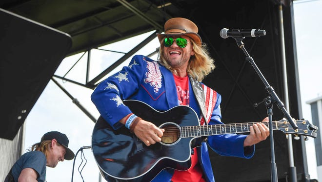 Ira Dean performs Mel Tillis songs while wearing a jacket that the late Tillis gave him at the Budweiser Forever Country Stage at the CMA Music Festival in Nashville on Saturday, June 9, 2018.
