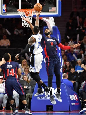Pistons center Andre Drummond (0) defends a shot by Magic forward Jeff Green (34) in the fourth quarter.