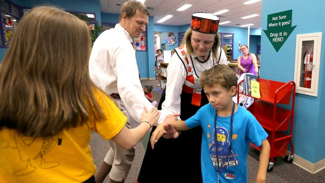 The Latvian dance troupe Dandari performed for free at the Linebaugh Library on Thursday, June 11, 2015, as they encouraged the spectators to dance along with them.