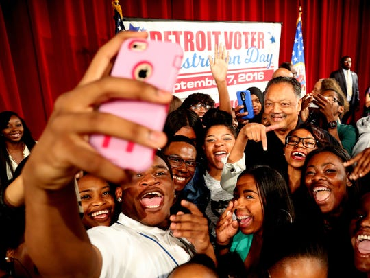 Rev. Jesse Jackson takes a selfie with several members