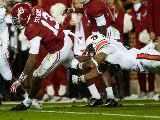 Alabama wide receiver ArDarius Stewart (13) breaks the tackle of Auburn defensive back Tray Matthews (28) on his way to a touchdown during the Iron Bowl at Bryant Denny Stadium in Tuscaloosa, Ala. on Saturday November 26, 2016. (Mickey Welsh / Montgomery Advertiser)
