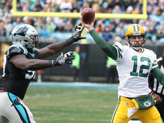 Green Bay Packers quarterback Aaron Rodgers (12) throws under pressure against the Carolina Panthers on Dec. 17, 2017, at Bank of America Stadium in Charlotte, N.C.