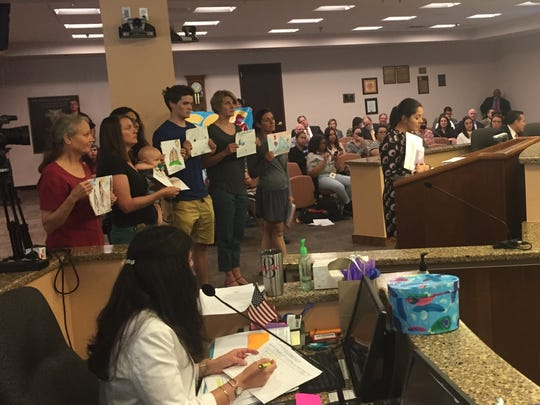 Xochitl Rodriguez shows City Council drawings that