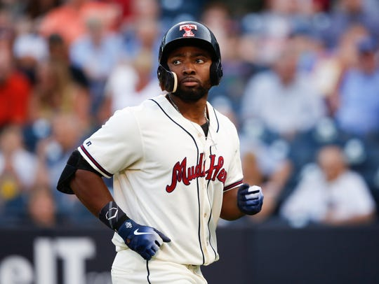 Toledo Mud Hens outfielder Christin Stewart reacts