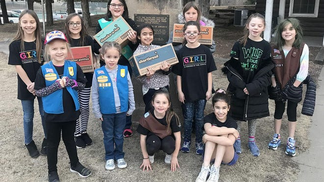 Girl Scouts from Pratt Troop 50181 hold boxes of Girl Scout cookies that are now on sale through March 22. Troop 50181 has had a 400 percent increase in membership.
