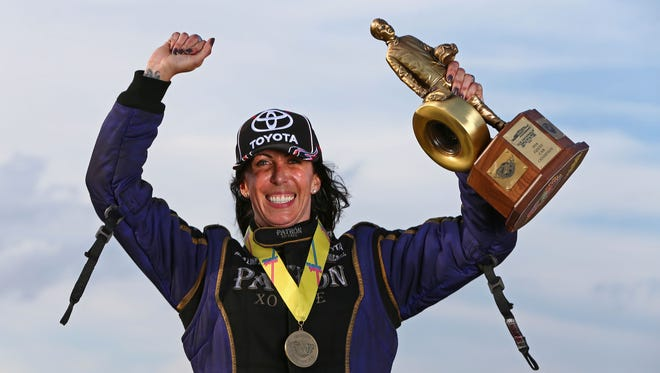 Alexis DeJoria celebrates after winning the Funny Car event Monday at the U.S. Nationals.