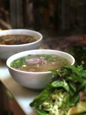 Bowls of Pho ready to be served at Pho Que Huong in Madison Heights on Monday, October 26, 2015.