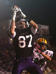 Cyclones forward Michael Jacobson, who was also a star football player for Waukee High School, is shown making a catch during a 2013 prep football game versus Des Moines Hoover.