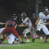 Holy Cross' Rob Rodolico looks for running room during Friday's game against Cinnaminson.