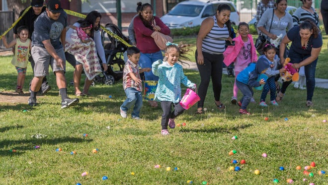 About 700 people participated Saturday, April 15, 2017 in the Police Activities League's annual easter egg hunt at Lincoln Oval Park. The scramble for 4,000 plastic eggs scattered on the lawn lasted about two-minutes. Eggs were split into two groups, 5-years-old or younger and 6- to 17-years-old. While most of the eggs contained candy, 12 had a ticket for a new bike and helmet. Another 66 had a ticket for a wrapped easter basket.