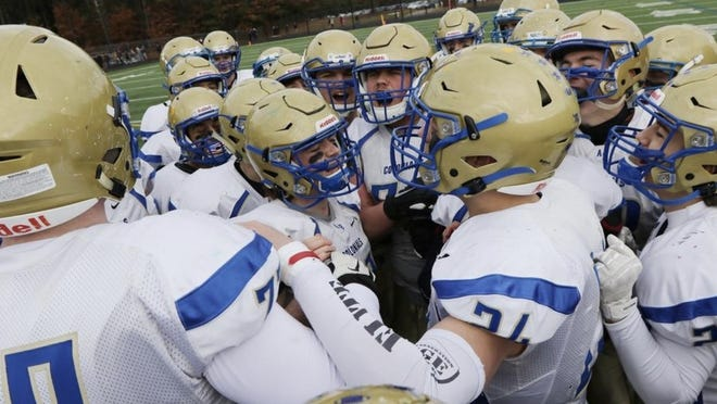 The Acton-Boxborough football team gathers before facing Westford Academy for their traditional Thanksgiving Day matchup Nov. 28, 2019.