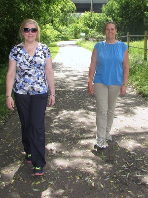 Marlena Giammichele, left, of Elmira, and Jennifer Myers, of Painted Post, walk along the Lackawanna Trail in Elmira during a break from their jobs at  Kennedy Valve.