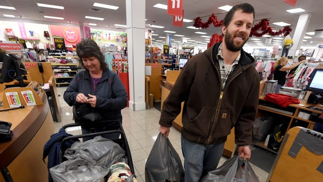 Kyle Kessler, right, and his mother Pam, check out at the Kohl's in West Manchester Township on Friday, Nov. 24, 2017. The duo from Conewago Township have made Black Friday a tradition to spend time together and purchase holiday gifts for family.