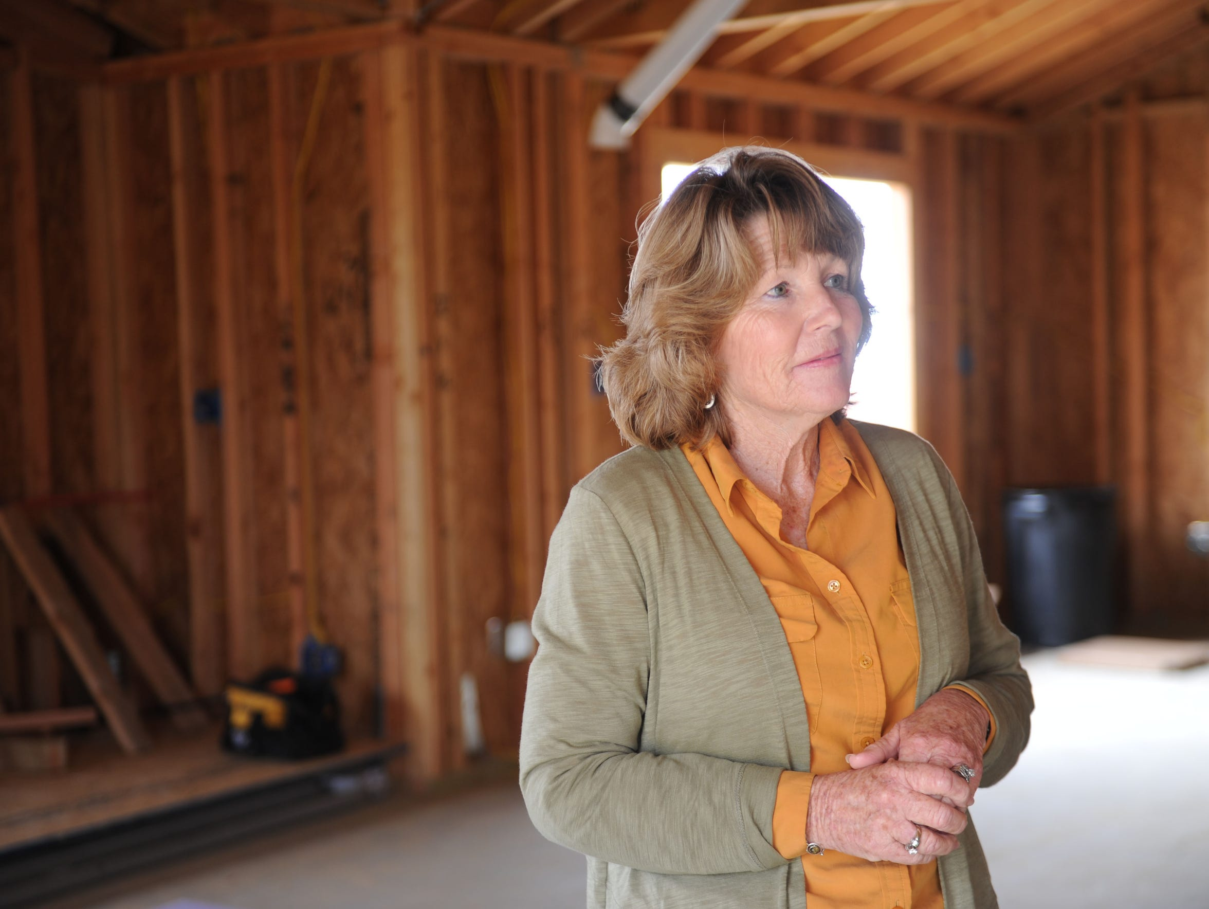 Sandra Fuller is inside her husband Ed's workshop that needs windows and drywalling. Their property was destroyed by the Thomas Fire. She lives in the Ondulando neighborhood in Ventura and is the first household to get a building permit.