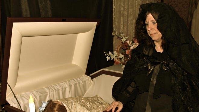 Kelly Guarano talks about funeral customs as the Governor Warner Mansion becomes haunted for one night.