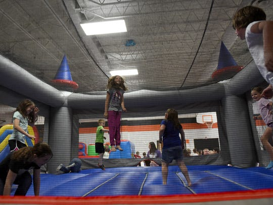 A group of Ridgewood Elementary students jump in a