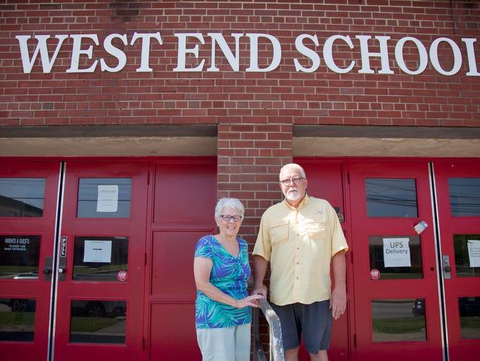 Deborah and Robert Blair, founders of West End School, pose at the school's entrance. June 17, 2014