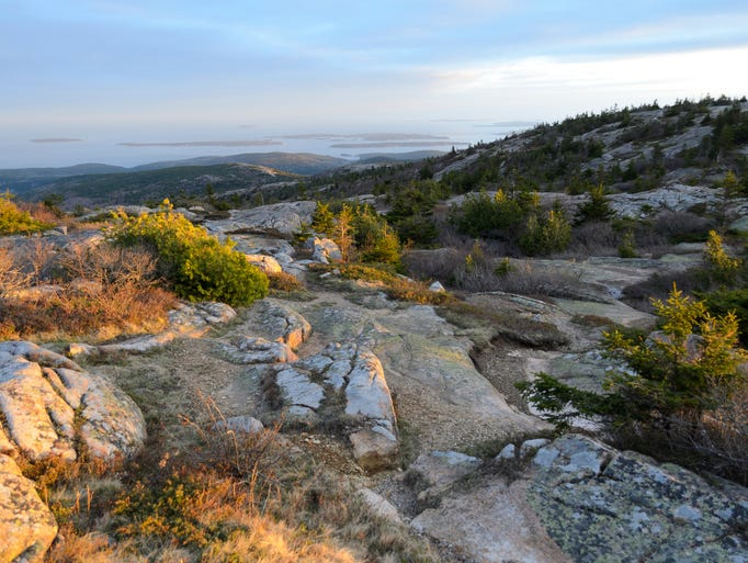 We asked 10Best and USA TODAY readers to help us pick the 'Best National Park,' and the results are in. Occupying much of Maine's Mount Desert Island, stunning Acadia National Park took top honors. Pictured here is the view at sunset from Cadillac Mountain.
