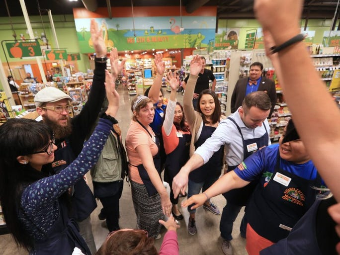 Rachel Denny Clow/Caller-Times Natural Grocers employees come together before opening the store Tuesday, March 15, 2016. The store, which is located in an old Walgreens at Staples and Doddridge streets, stocks its shelves with fresh produce that is exclusively certified organic by the U.S. Department of Agriculture, along with a mix of national brands and locally-grown and raised products from Texas.
