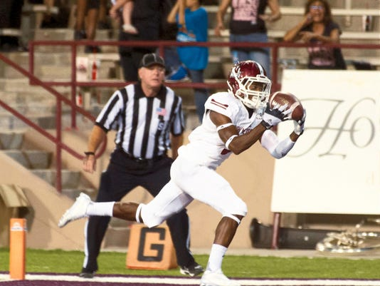 Gary Mook/ for the Sun-News New Mexico State junior receiver Tyrain Taylor hauls in a 29-yard touchdown pass during Saturday's 34-32 loss to Georgia State at Aggie Memorial Stadium. Taylor had 10 catches, two TDs and 206 receiving yards, sixth most on the NMSU single game list.