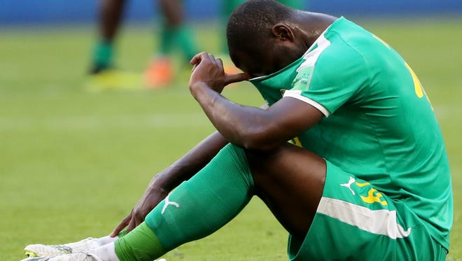 Moussa Konate of Senegal reacts after the loss against Colombia.