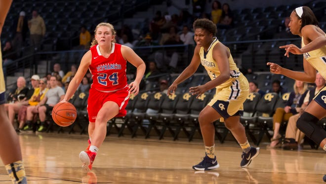Kat Phipps drives for St. Francis (N.Y.) women's basketball.
