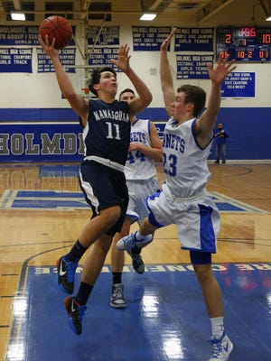 Brian Paturzo (11) of Manasquan drives to the basket against Brian Wischerath (23) during boys basketball game at Holmdel High School. Holmdel,NJ. Tuesday, February 9, 2016. Noah K. Murray-Special for the Asbury Park Press ASB 0210 Basketball Roundup