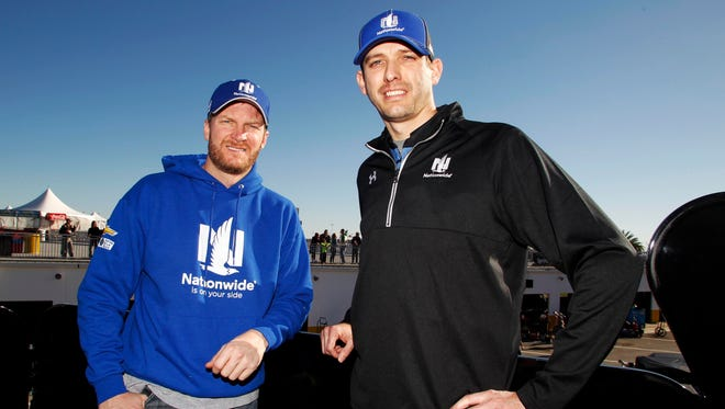 Dale Earnhardt Jr. and his crew chief Greg Ives, right, won their first race together Sunday at Talladega Superspeedway.