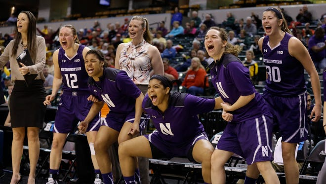 The Northwestern bench celebrates late in the second half of an NCAA college basketball game against the Minnesota at the Big Ten Conference tournament in Indianapolis, Thursday, March 3, 2016. Northwestern defeated Minnesota 84-74. (AP Photo/Michael Conroy)