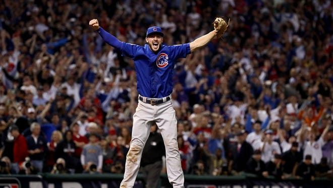 CLEVELAND, OH - NOVEMBER 02:  Kris Bryant #17 of the Chicago Cubs celebrates after defeating the Cleveland Indians 8-7 in Game Seven of the 2016 World Series at Progressive Field on November 2, 2016 in Cleveland, Ohio. The Cubs win their first World Series in 108 years.  (Photo by Ezra Shaw/Getty Images) *** BESTPIX *** ORG XMIT: 678125603 ORIG FILE ID: 620749086