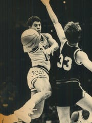 Iowa's Steve Carfino drives against Purdue's Curt Clawson during an early 1980s game.