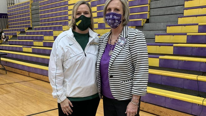 A.C. Reynolds volleyball coach Lori Ledford, left, poses with her former middle school coach, North Henderson's Sue Moon, on Thursday night prior to their match at North.