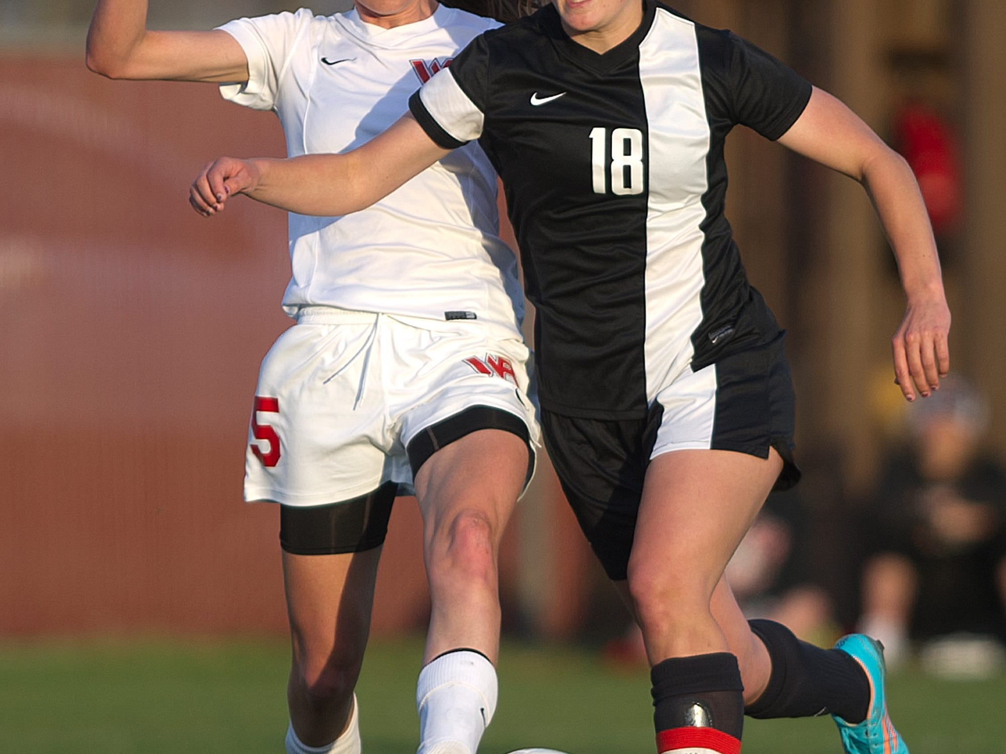 Wisconsin Rapids' Kaitlyn Hess, left, works against Stevens Point Area Senior High's Abby Bohanski during a Wisconsin Valley Conference soccer game Tuesday at Washington Field in Wisconsin Rapids.